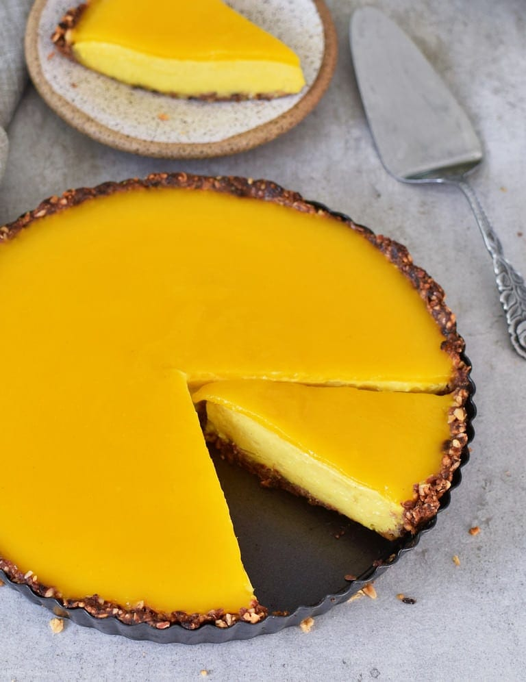 Vegan mango cheesecake with jelly and gluten-free crust