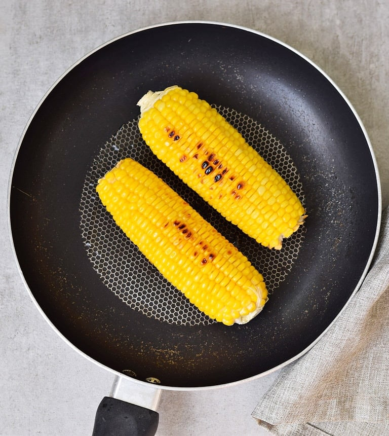 cooked fresh corn in a skillet