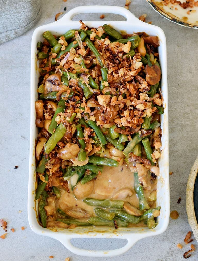 baked vegan green bean casserole with mushroom sauce
