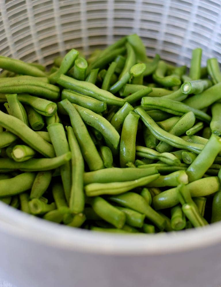 fresh green beans in a sieve