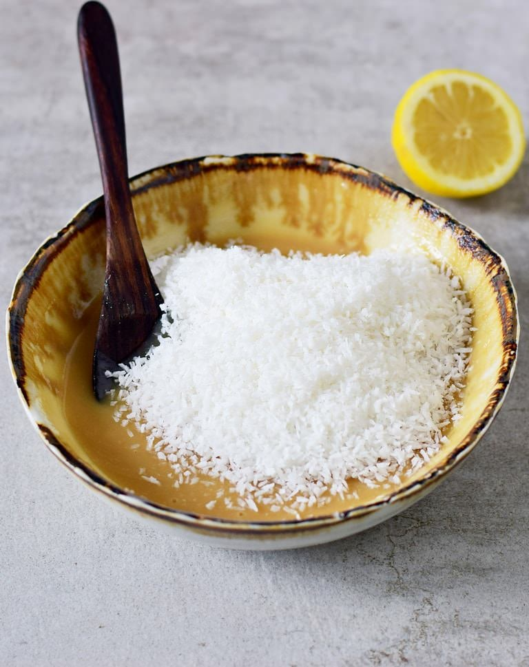 lemon balls mixture with shredded coconut