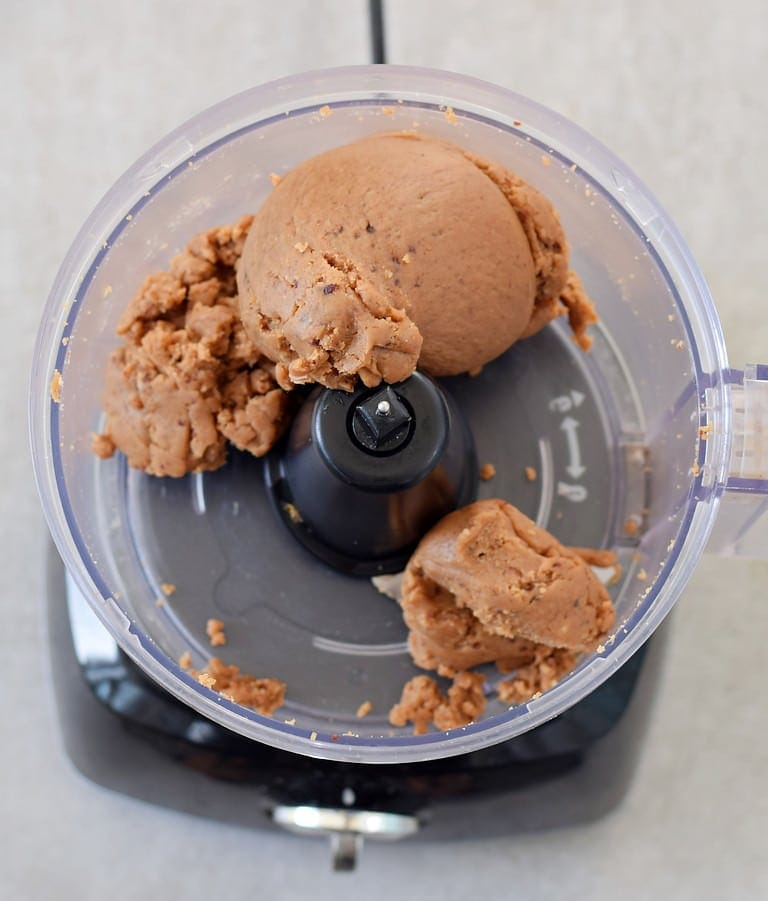mixed peanut butter cookie dough in a food processor
