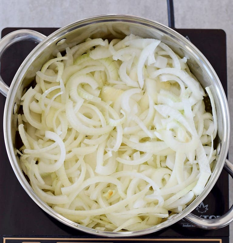 sliced white onions in a large pot