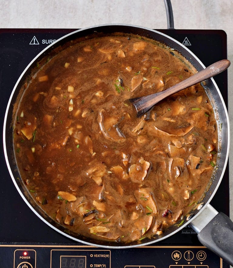 vegan gravy in a pan with mushrooms