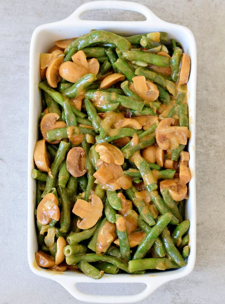 vegan green bean casserole before baking in a white baking dish