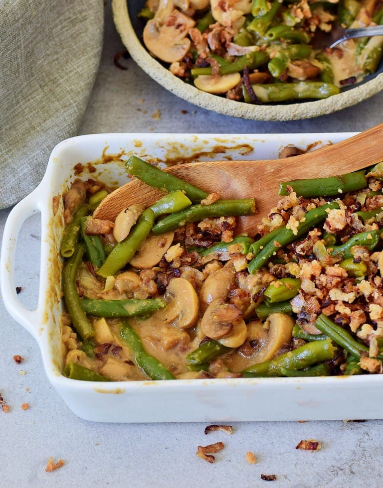 vegan green bean casserole in a white baking dish