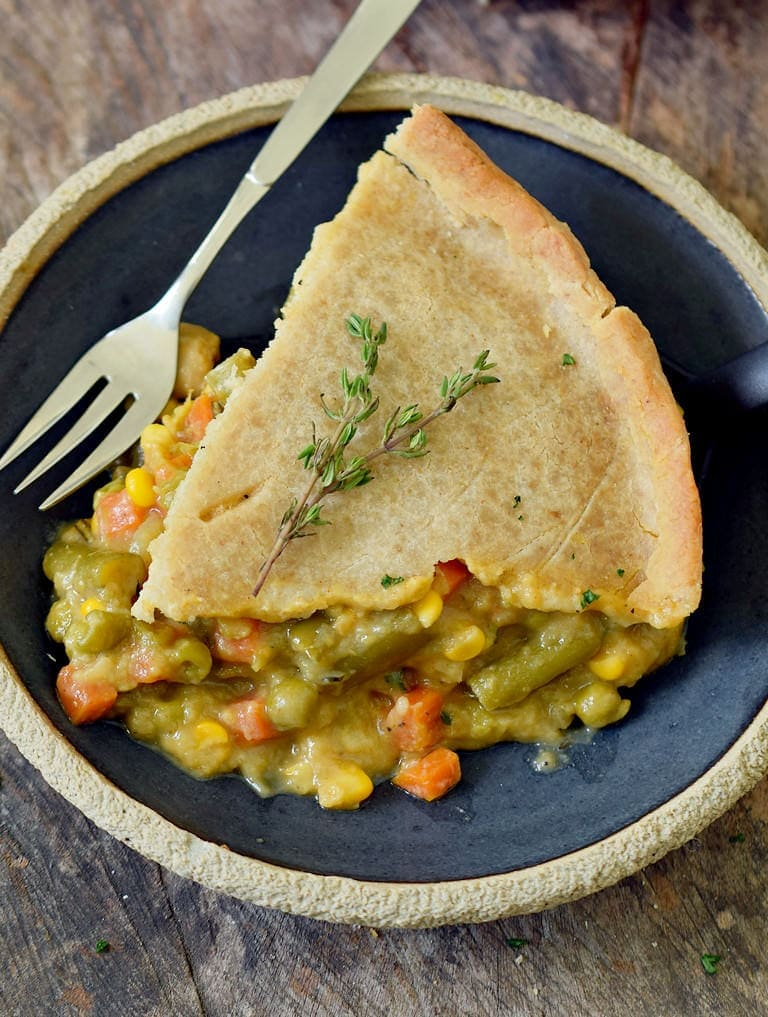 close up of vegetable pie on a black plate