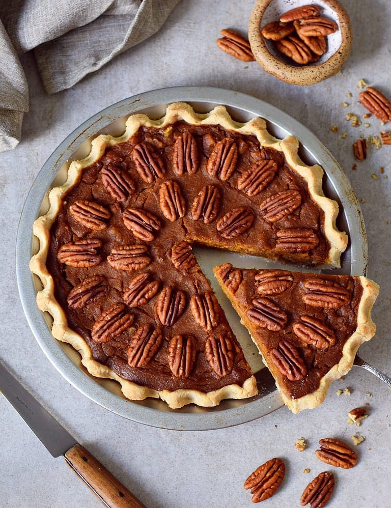 pecan pie from above with a piece cut out