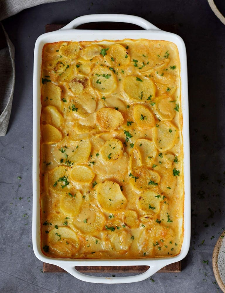 potato casserole in a white baking dish