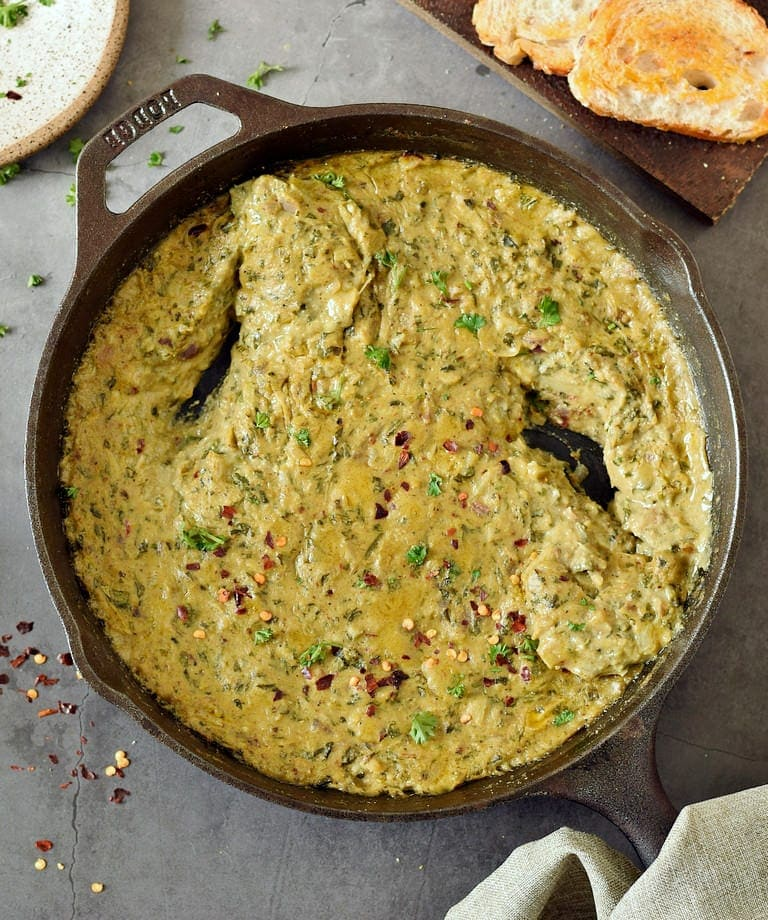 vegan gluten-free cheesy dip in a black skillet