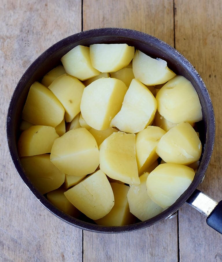 cooked potatoes in a black pot