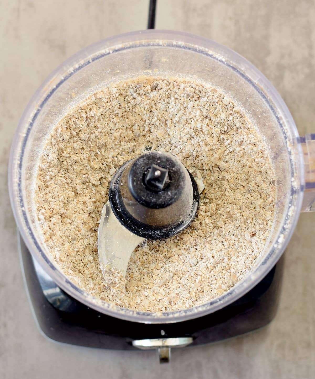 ground oats with sunflower seeds in a food processor