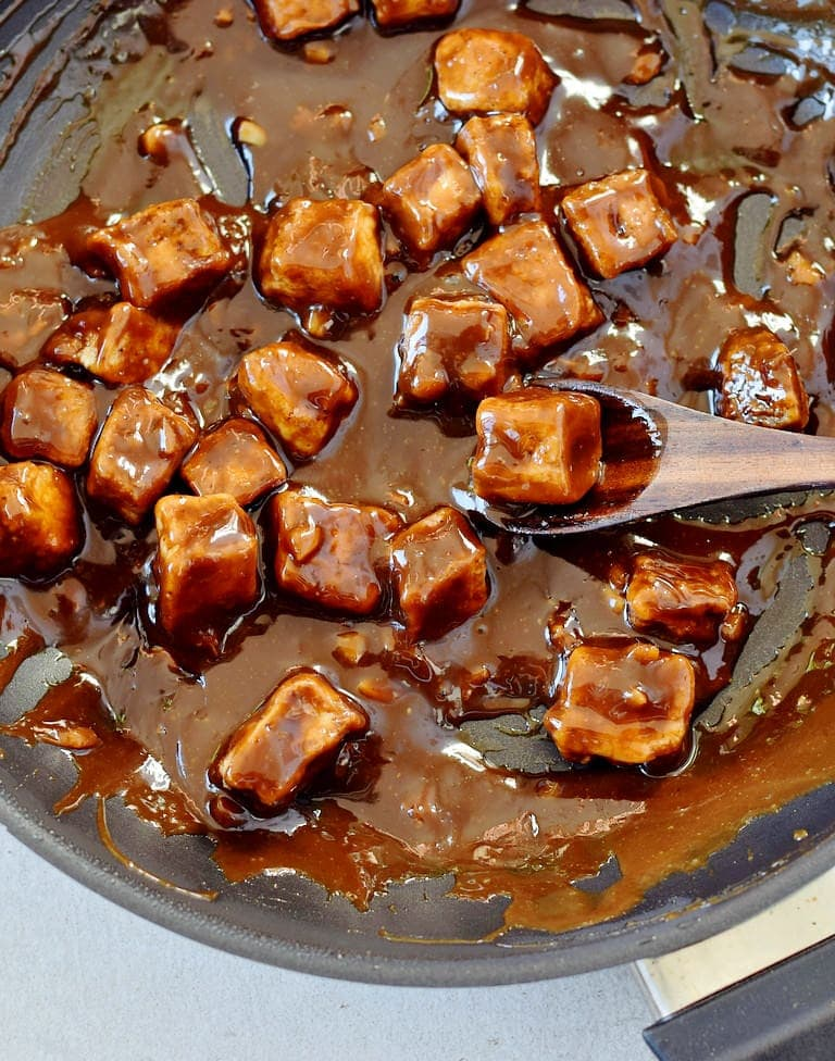 teriyaki sauce with tofu in a skillet