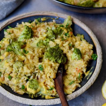 the best vegan risotto with broccoli and cheese on a plate