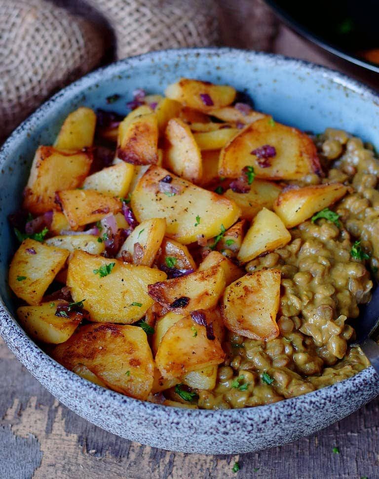 vegan roast potatoes with lentil stew in a bowl