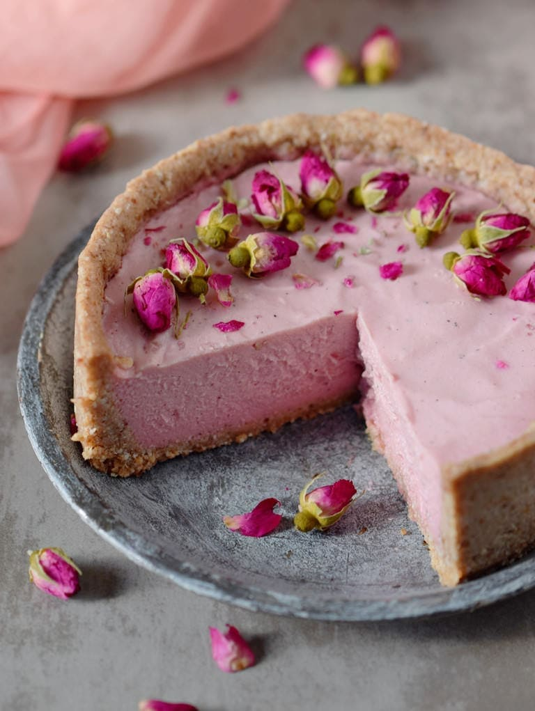 creamy pink vegan mousse cake with rose buds