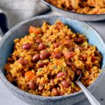 spanish rice and red beans in a bowl
