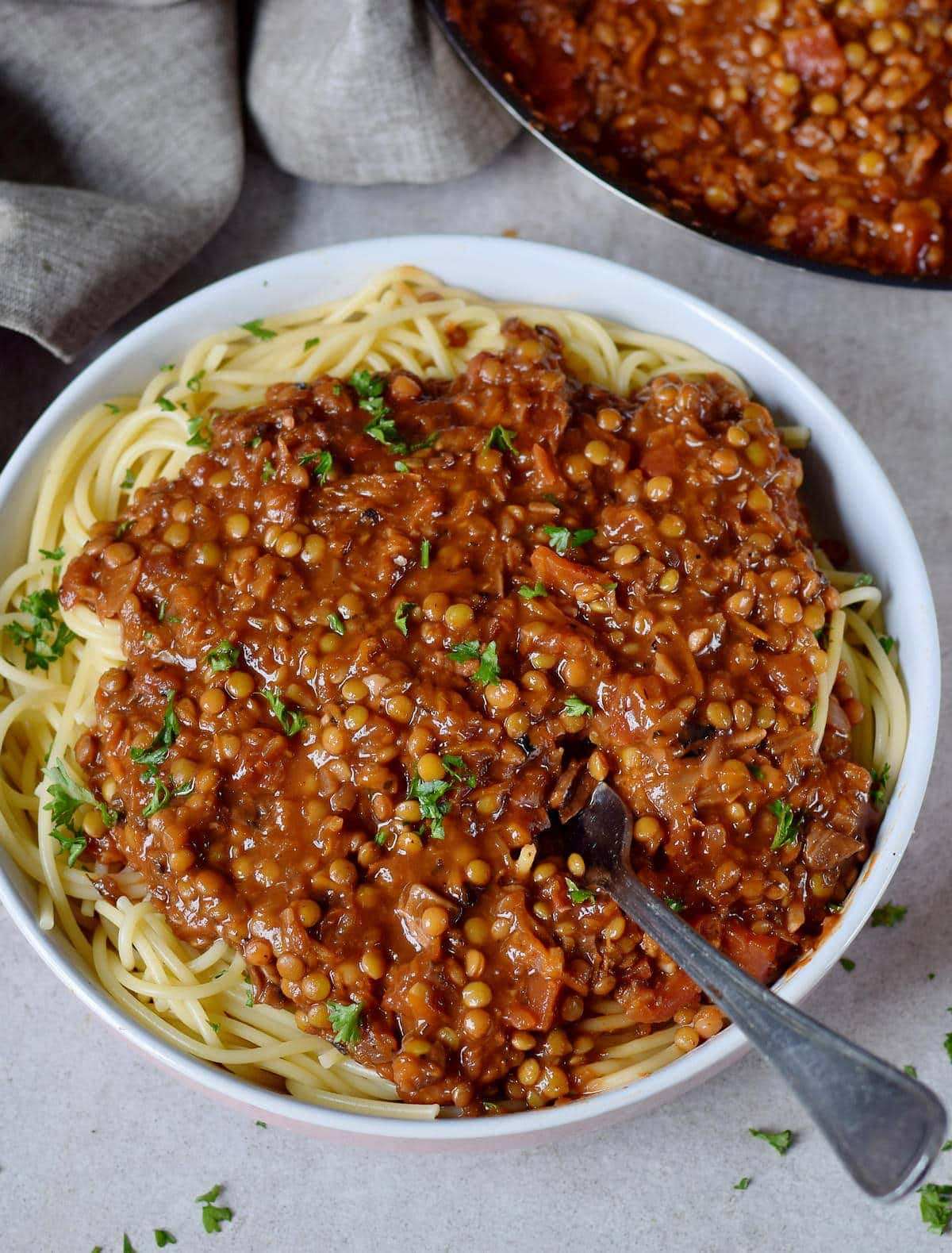 vegetarian bolognese with lentils over spaghetti