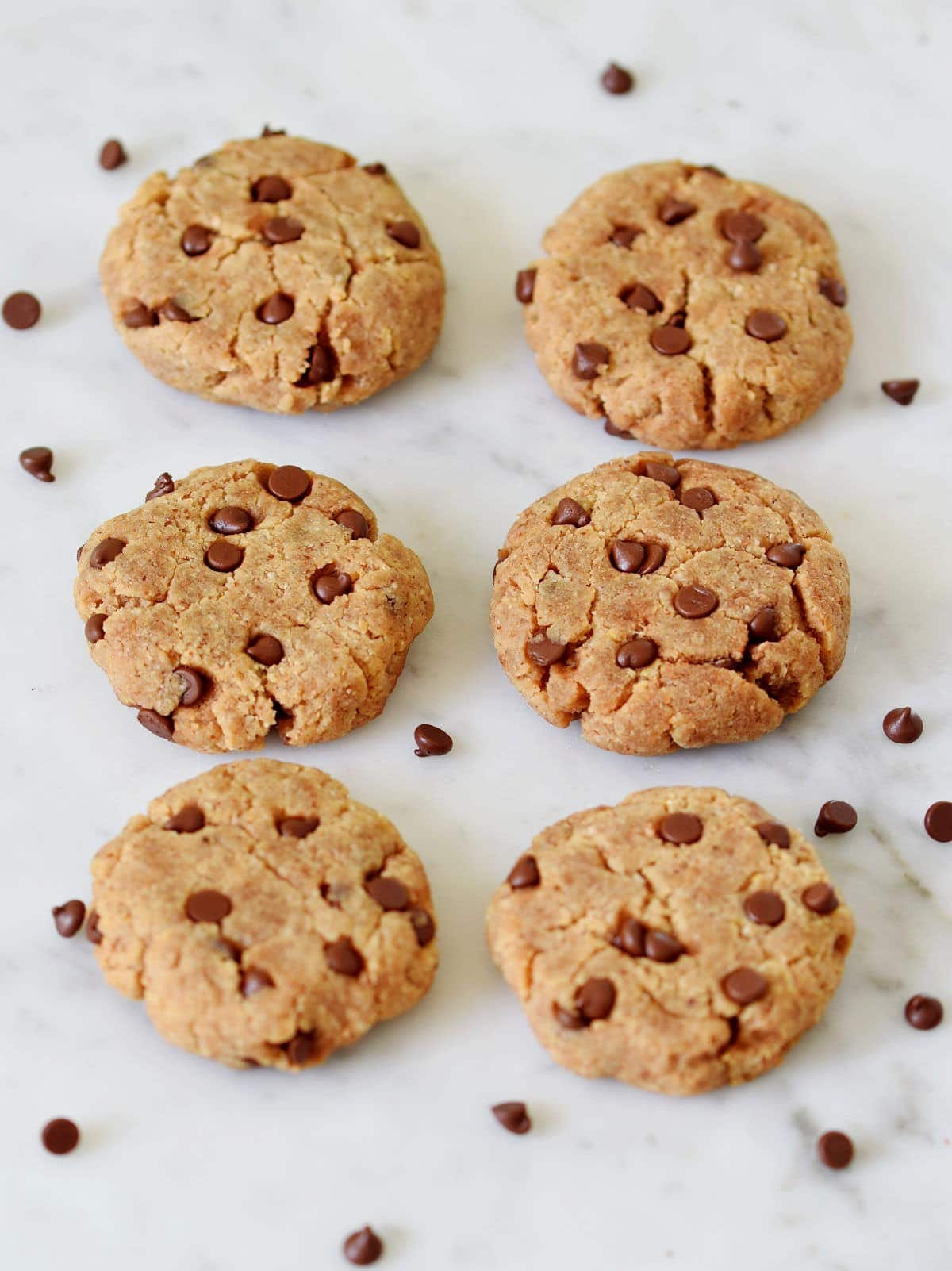 6 gluten-free vegan cookies on a marble tile from the side
