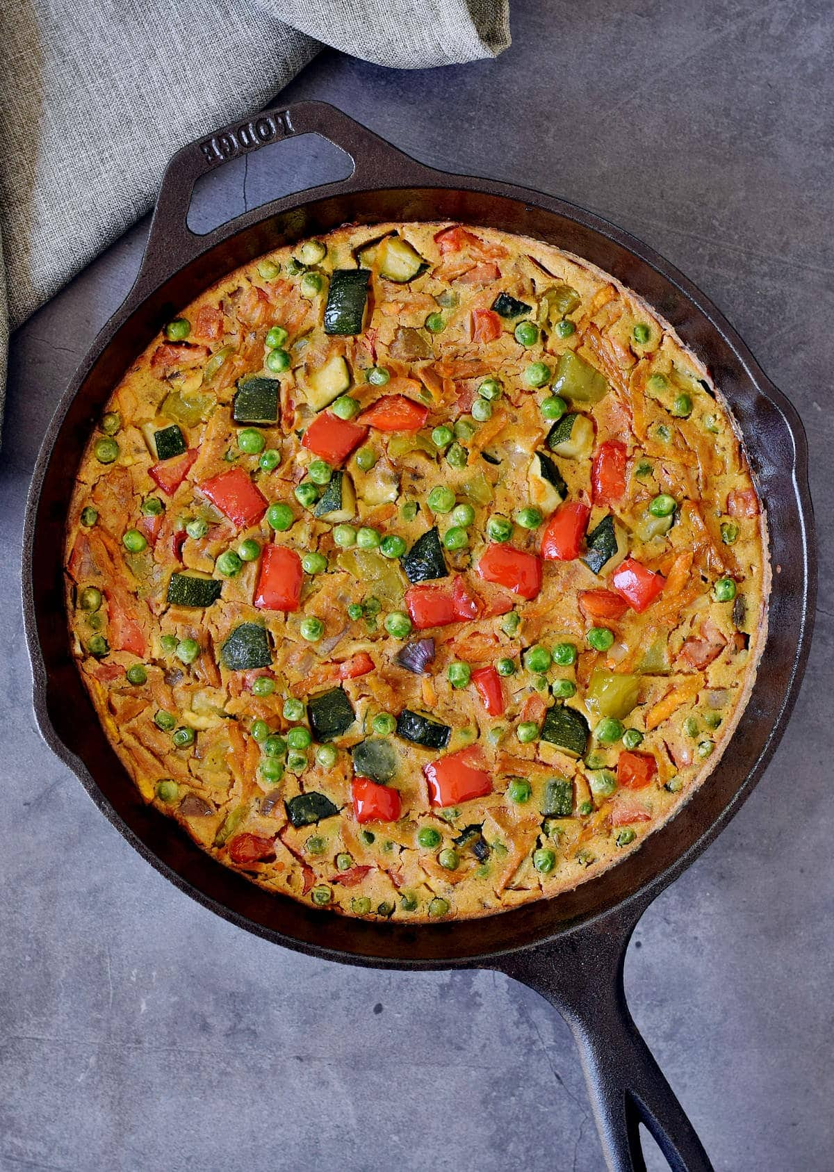 Oven-baked crustless quiche in a black skillet