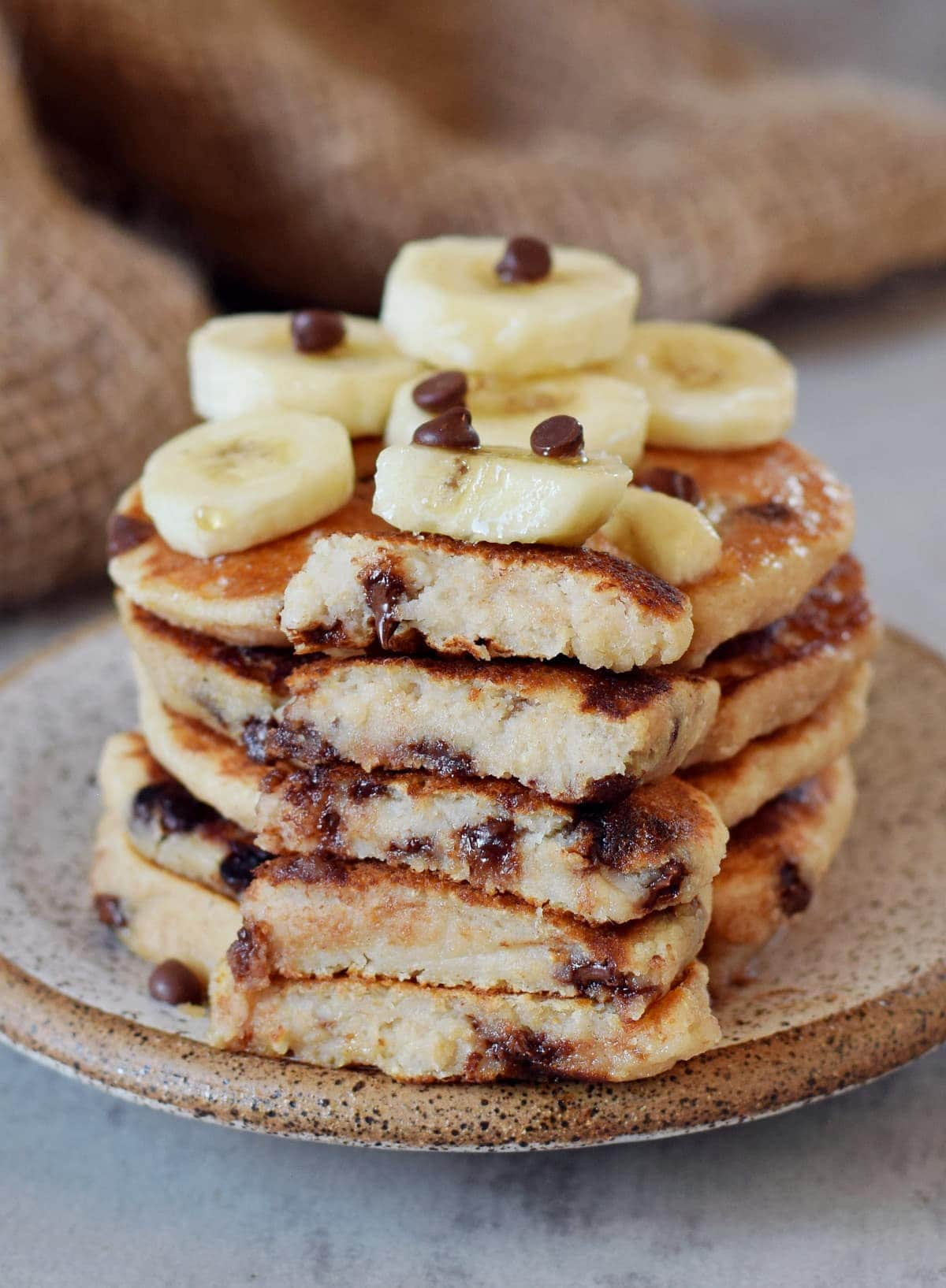 eggless pancake stack with chocolate and banana slices