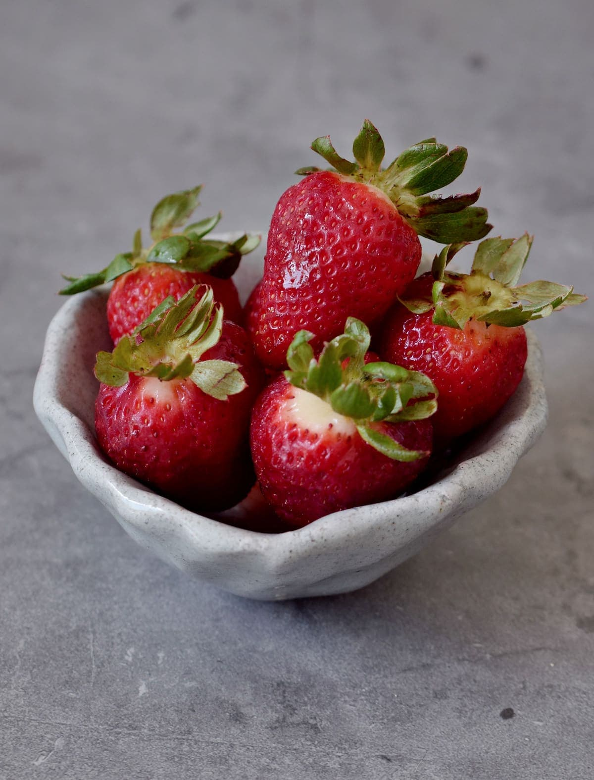 strawberries in a gray ceramic dish