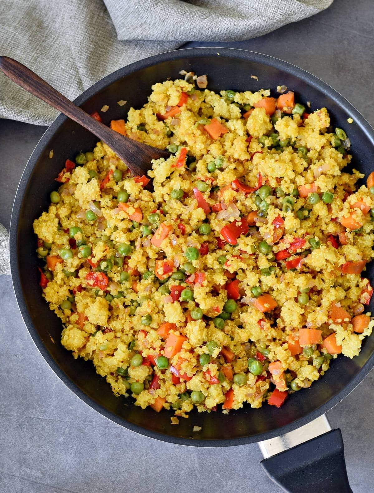 veggie stir fry in a black pan
