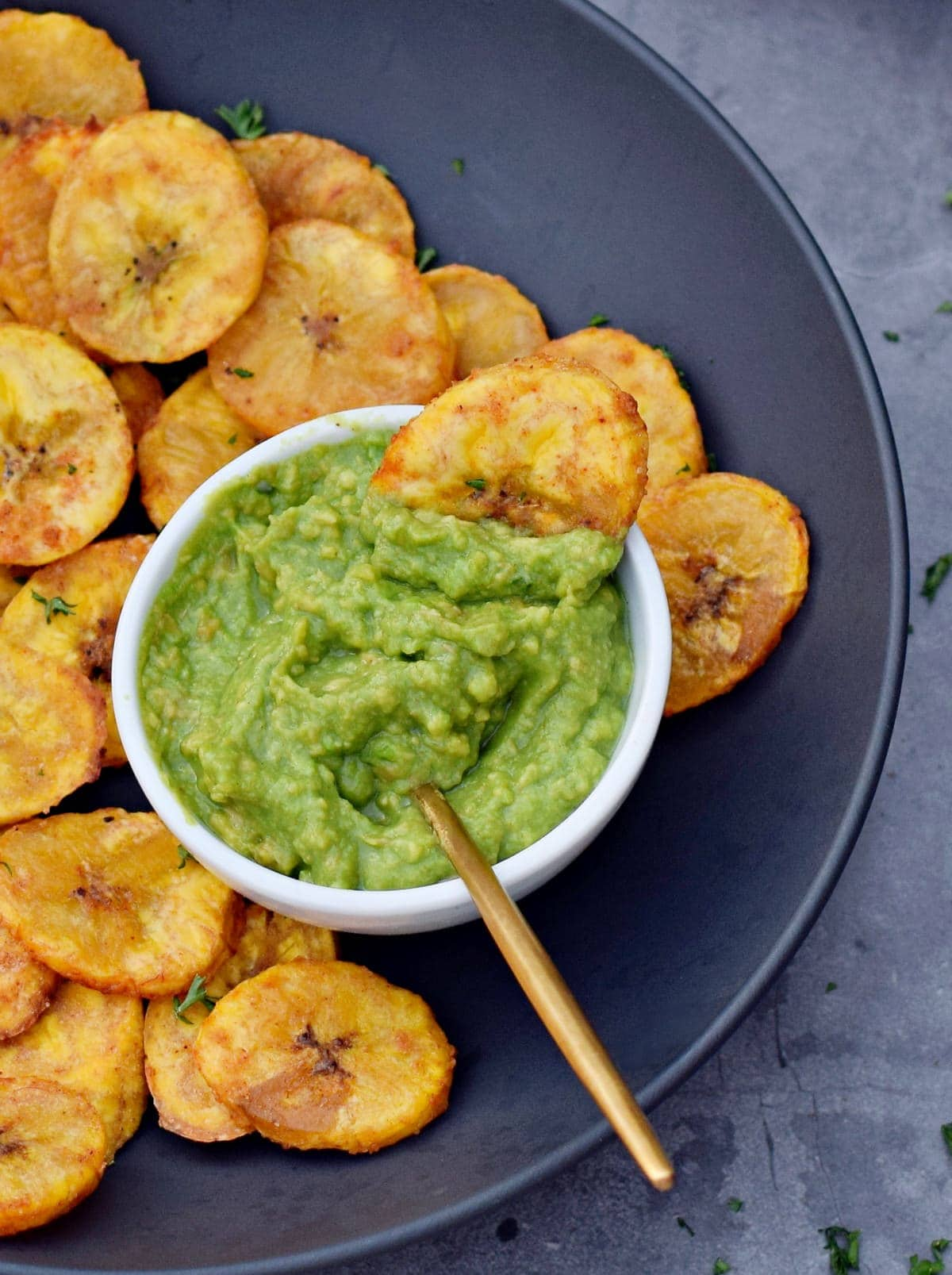 close-up of roasted plantains with guacamole