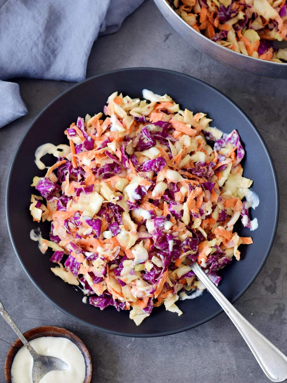 keto coleslaw in a black bowl with a fork