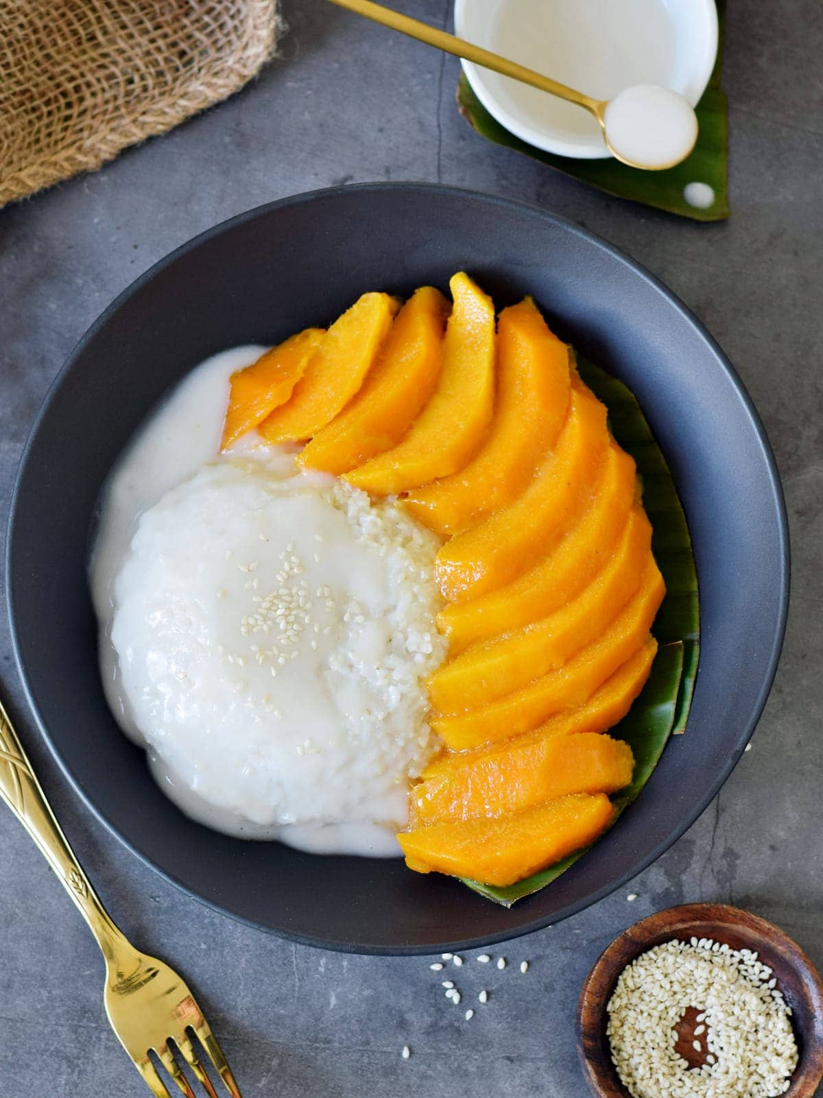 top view of Thai coconut sticky rice with sliced mango