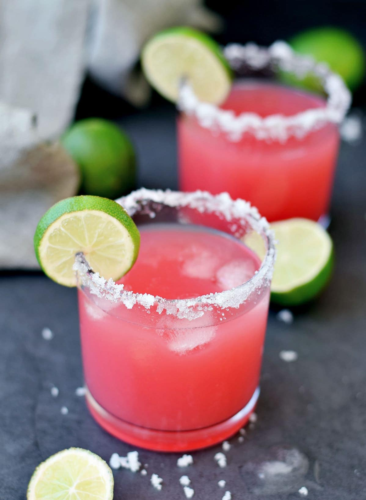 2 glasses of margaritas with watermelon and lime
