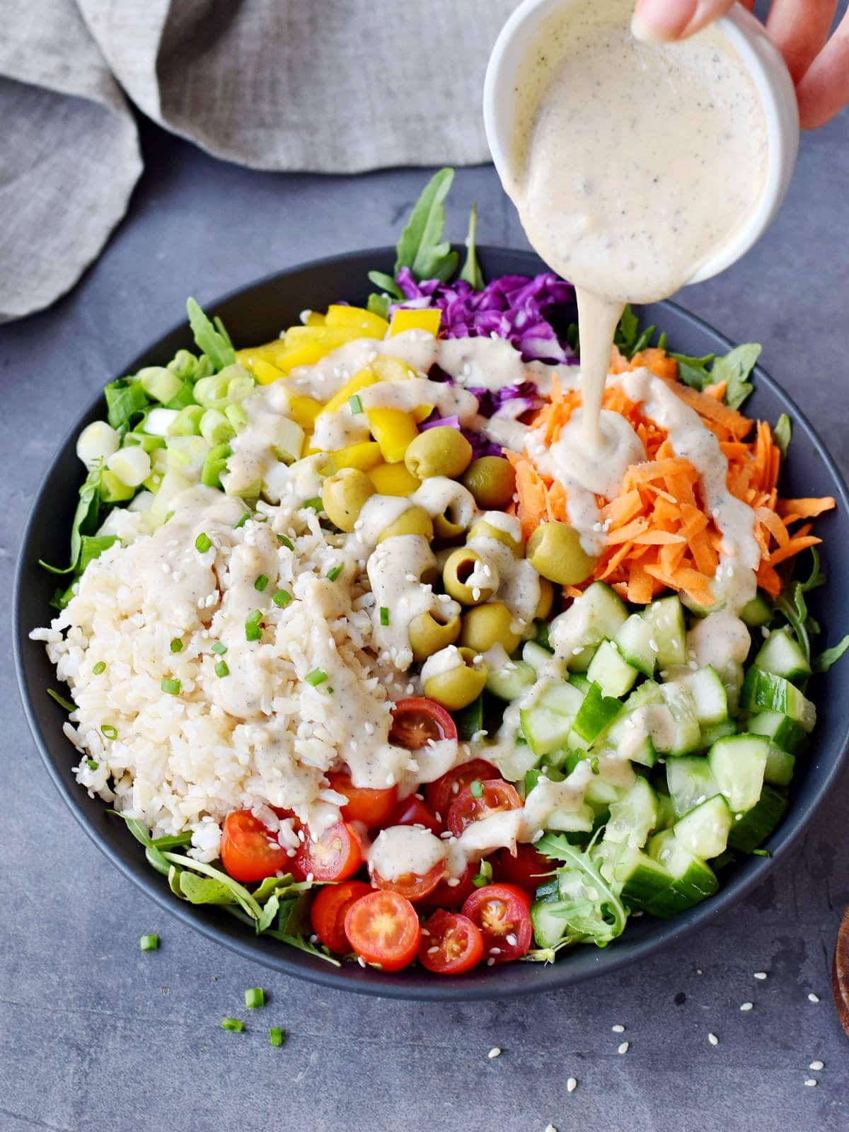 mediterranean rice salad with vegan dressing drizzle