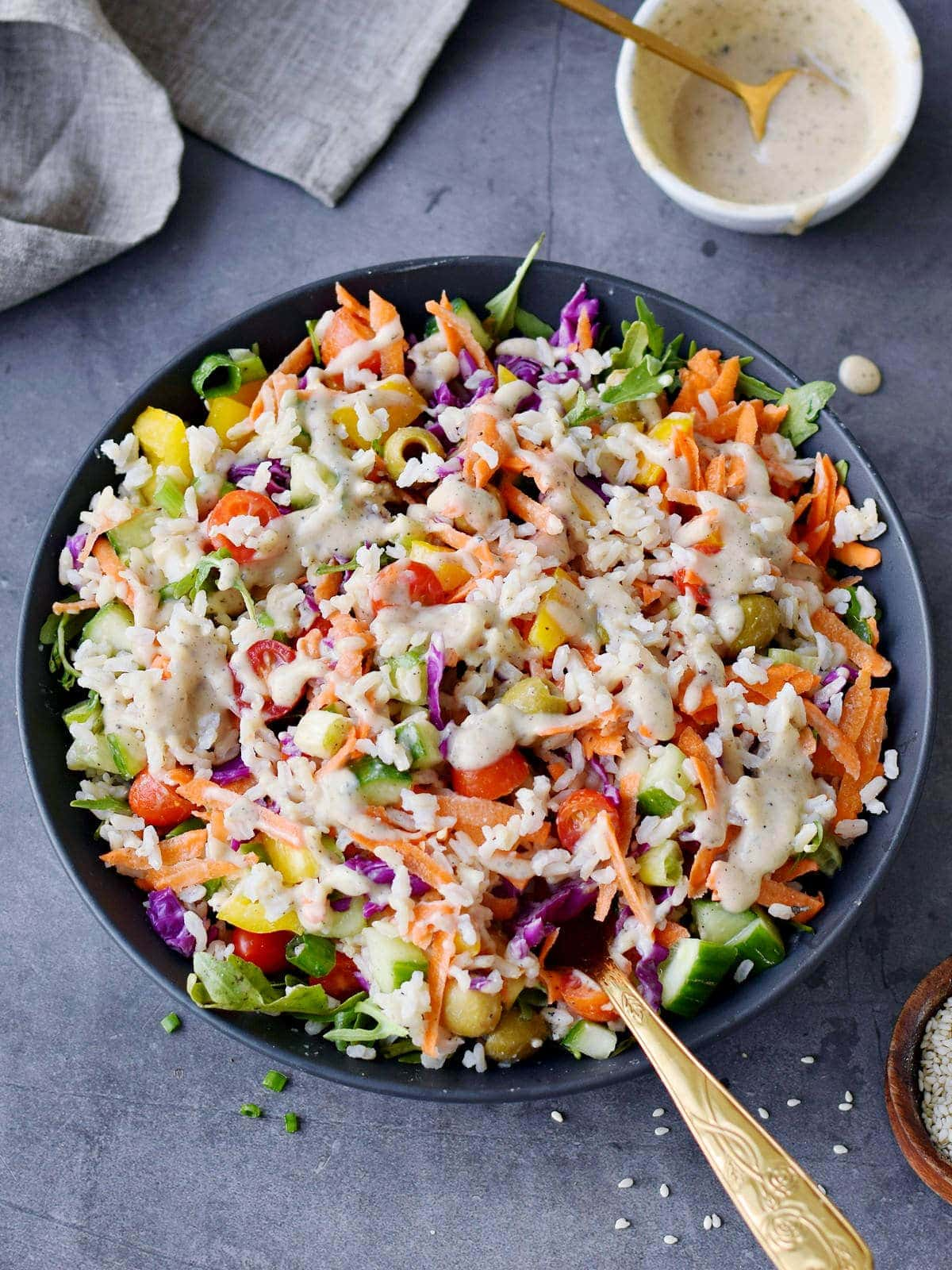 mixed summer rice salad with dressing in bowl