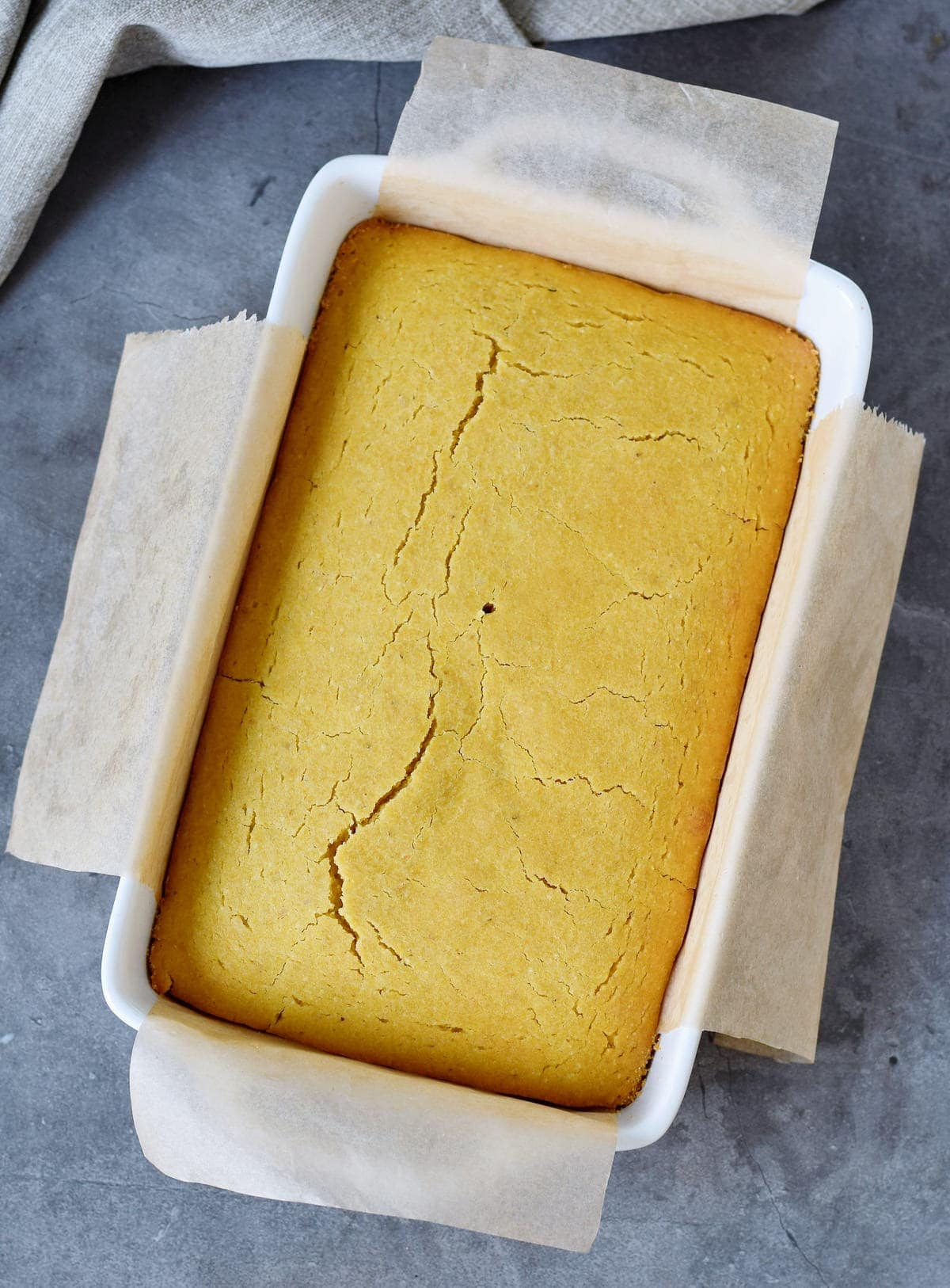 Yellow baked corn bread in baking dish