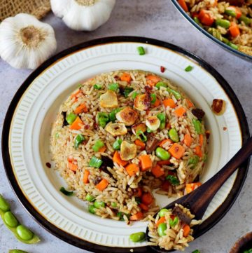 Japanese garlic fried rice with veggies on plate