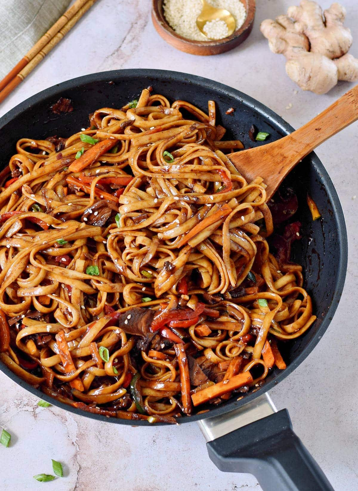 asian noodles with veggies in pan