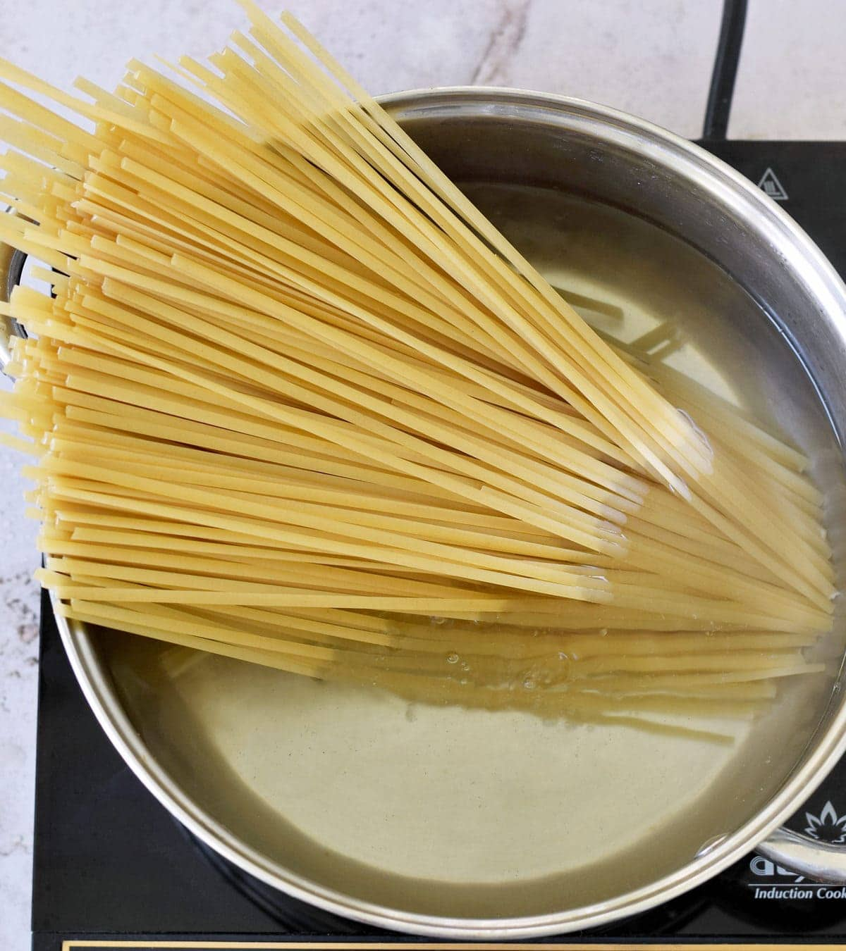 linguine in a large pot with water