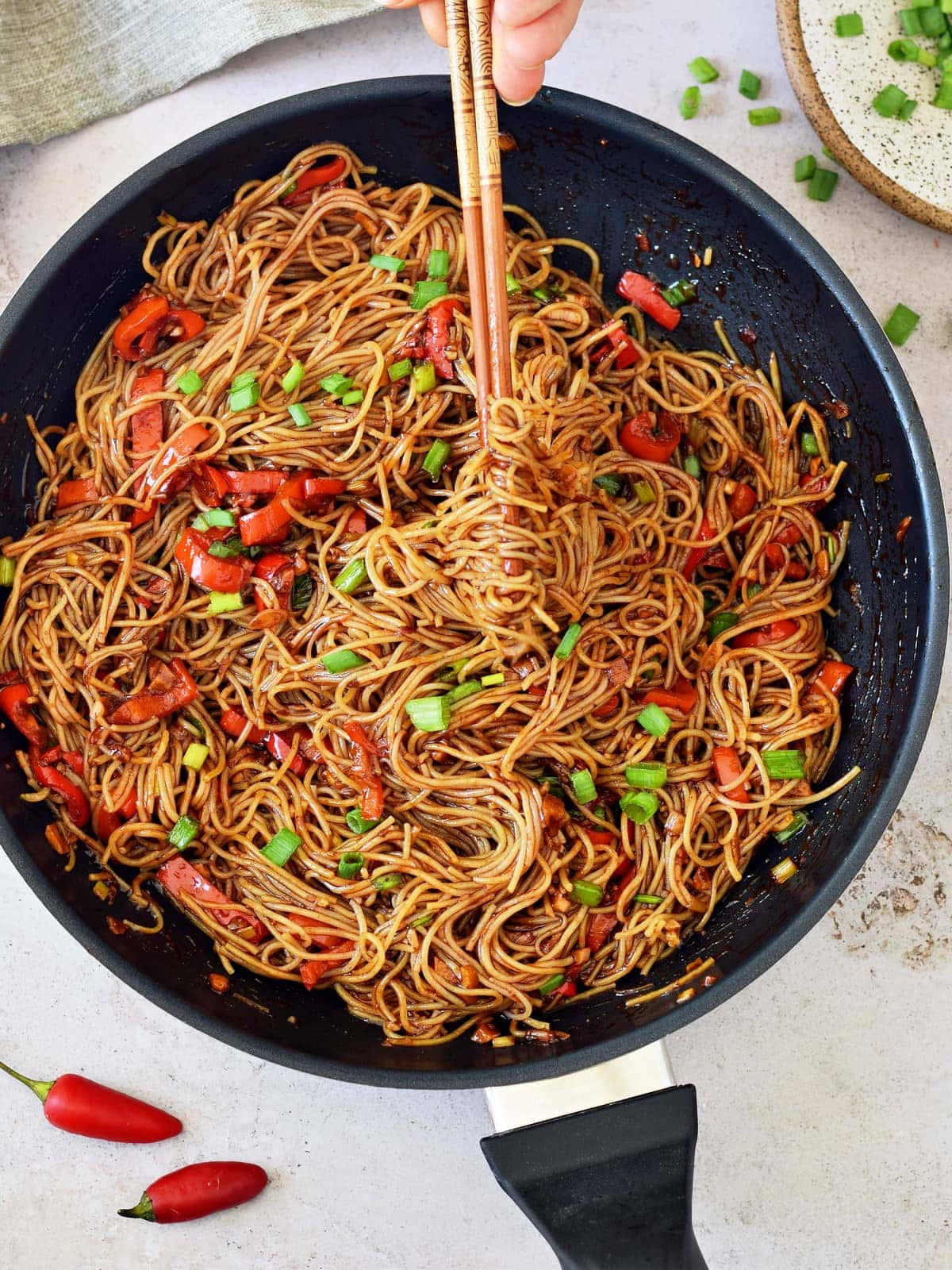 noodle skillet with hot Asian sauce
