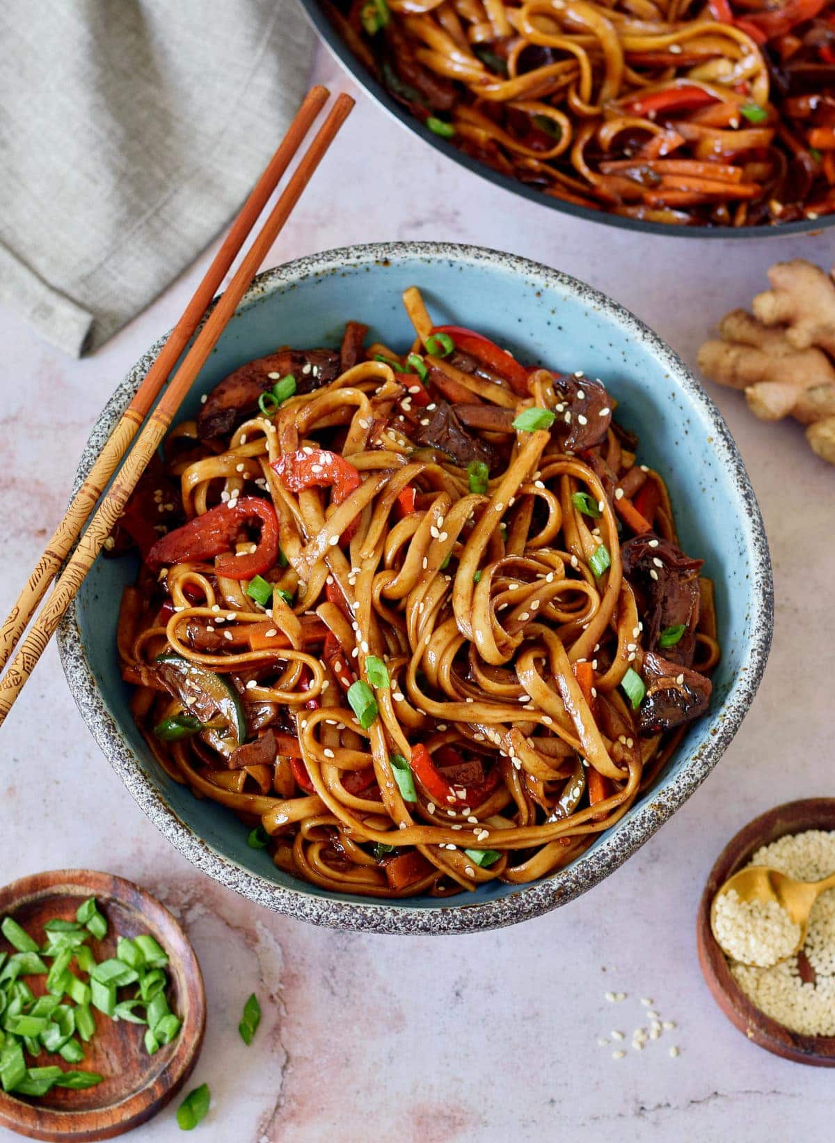 stir-fry noodles with veggies in bowl with chopsticks