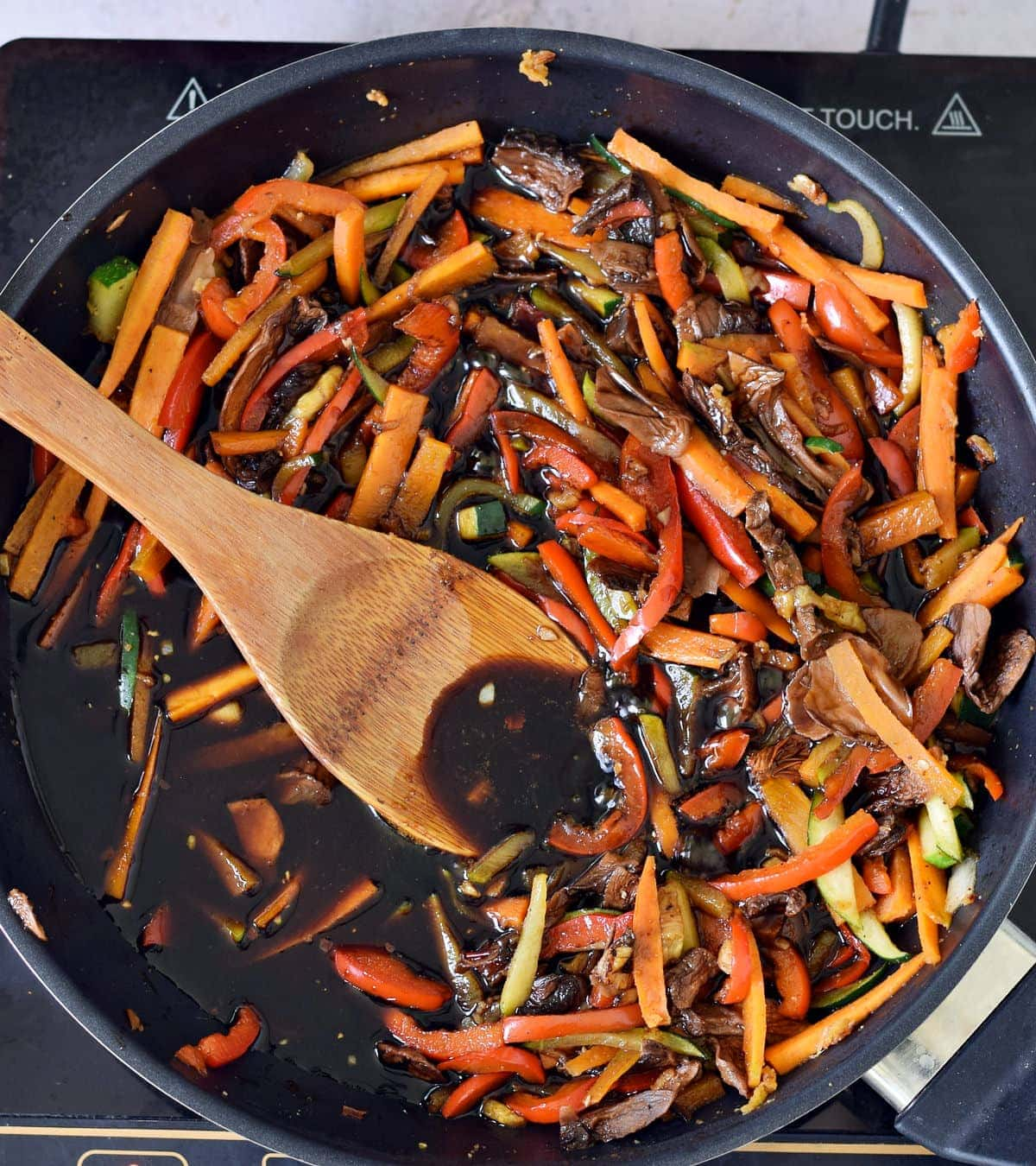 veggies with brown sauce in pan