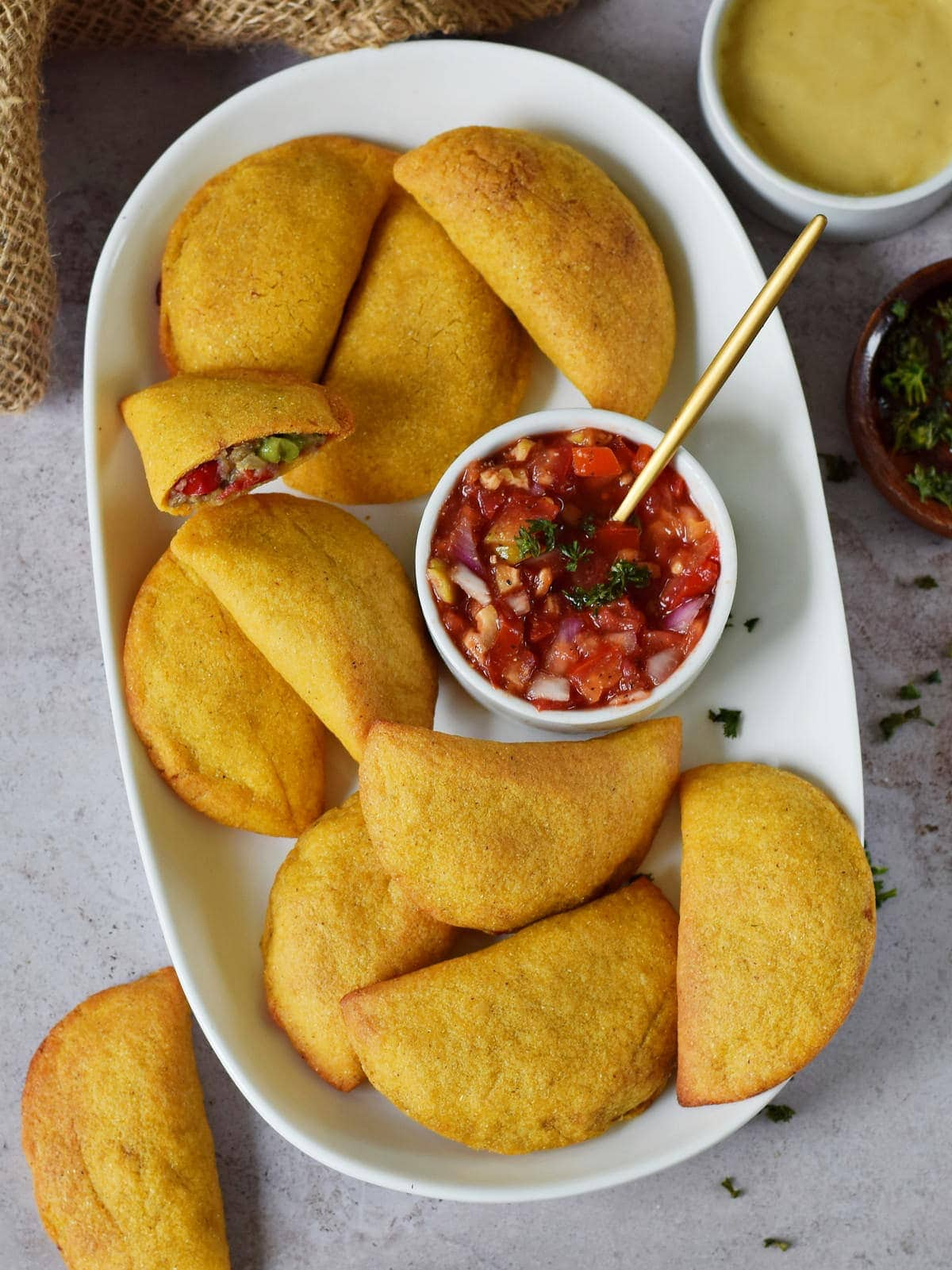 air fryer empanadas with homemade salsa on white plate