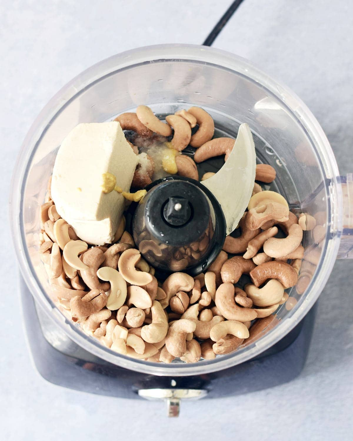cashews, silken tofu and condiments in food processor