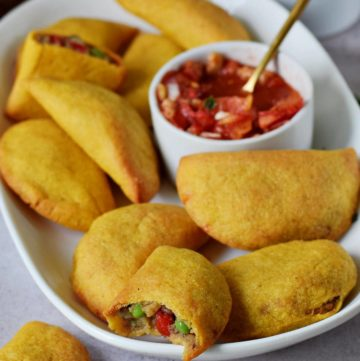 gluten-free empanadas on plate with salsa