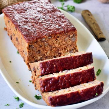 vegan meatloaf sliced on white plate