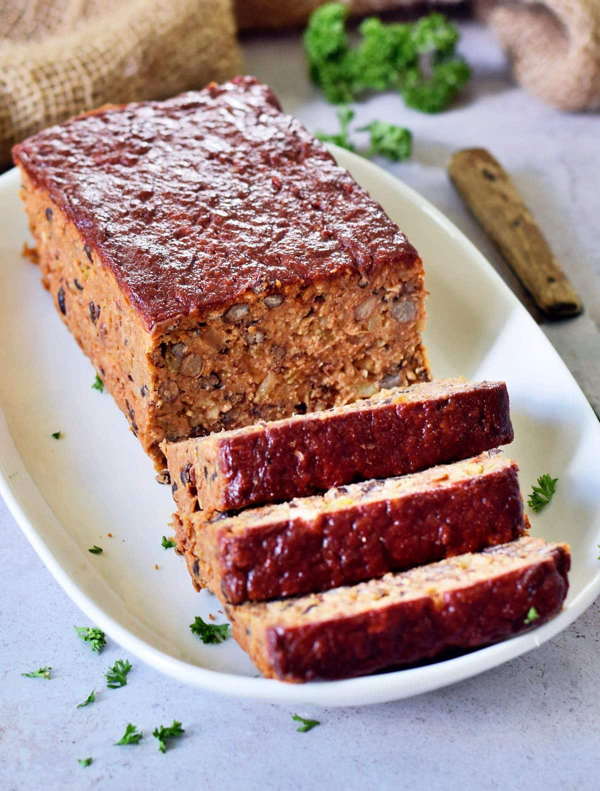 meatless meat loaf sliced on white plate