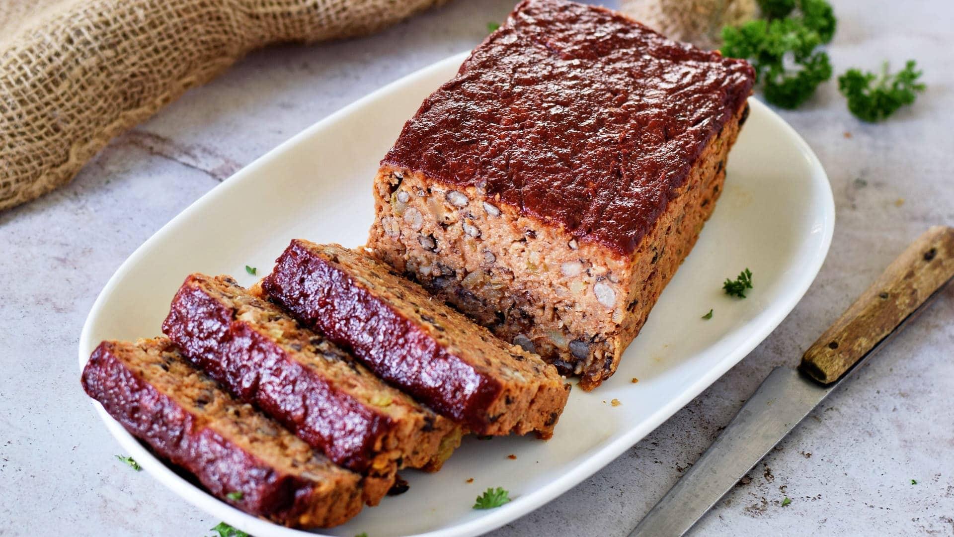sliced vegan meatloaf on white plate