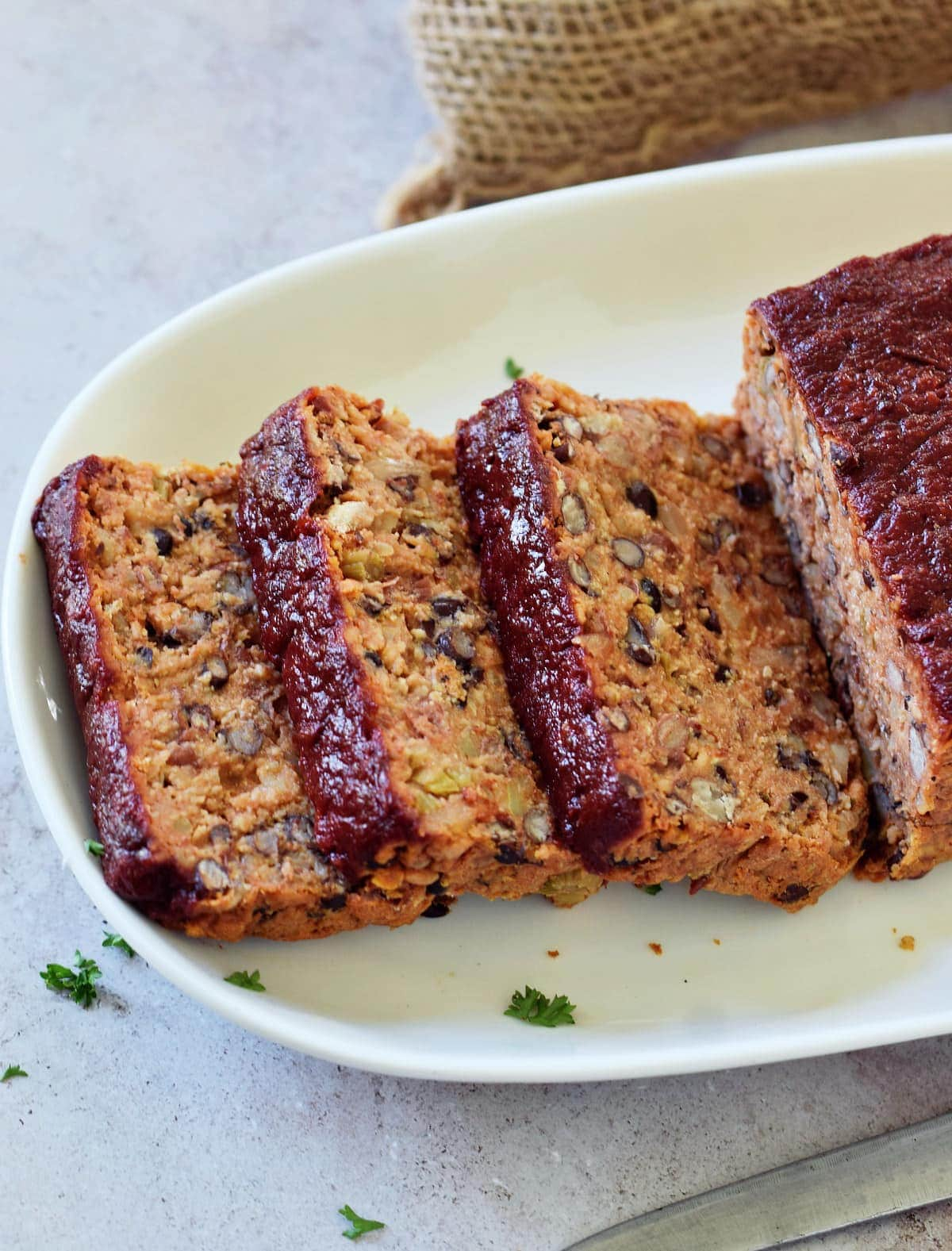 sliced vegetarian meatloaf on plate