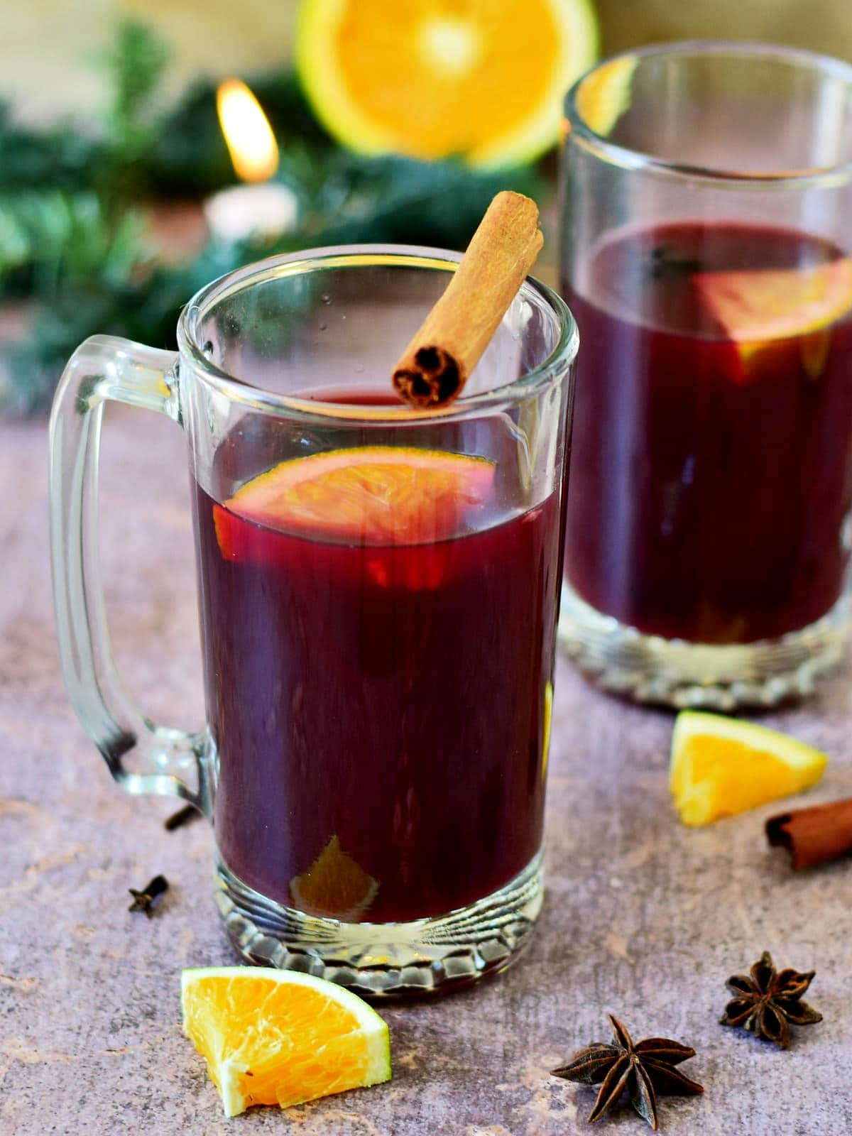 German mulled wine (punch) in 2 jars with orange slices and cinnamon stick