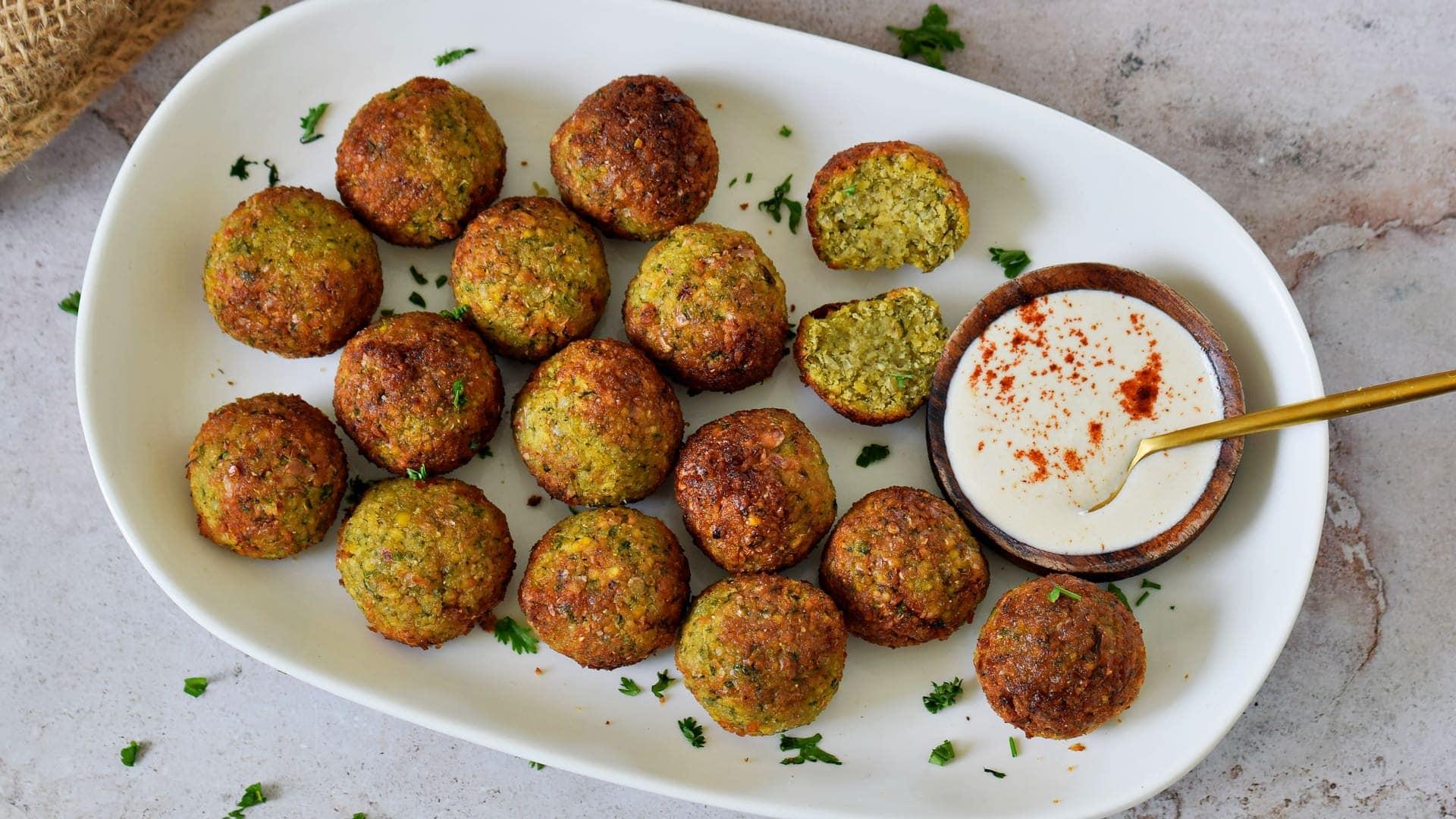 air fried falafel balls on plate with tahini dip