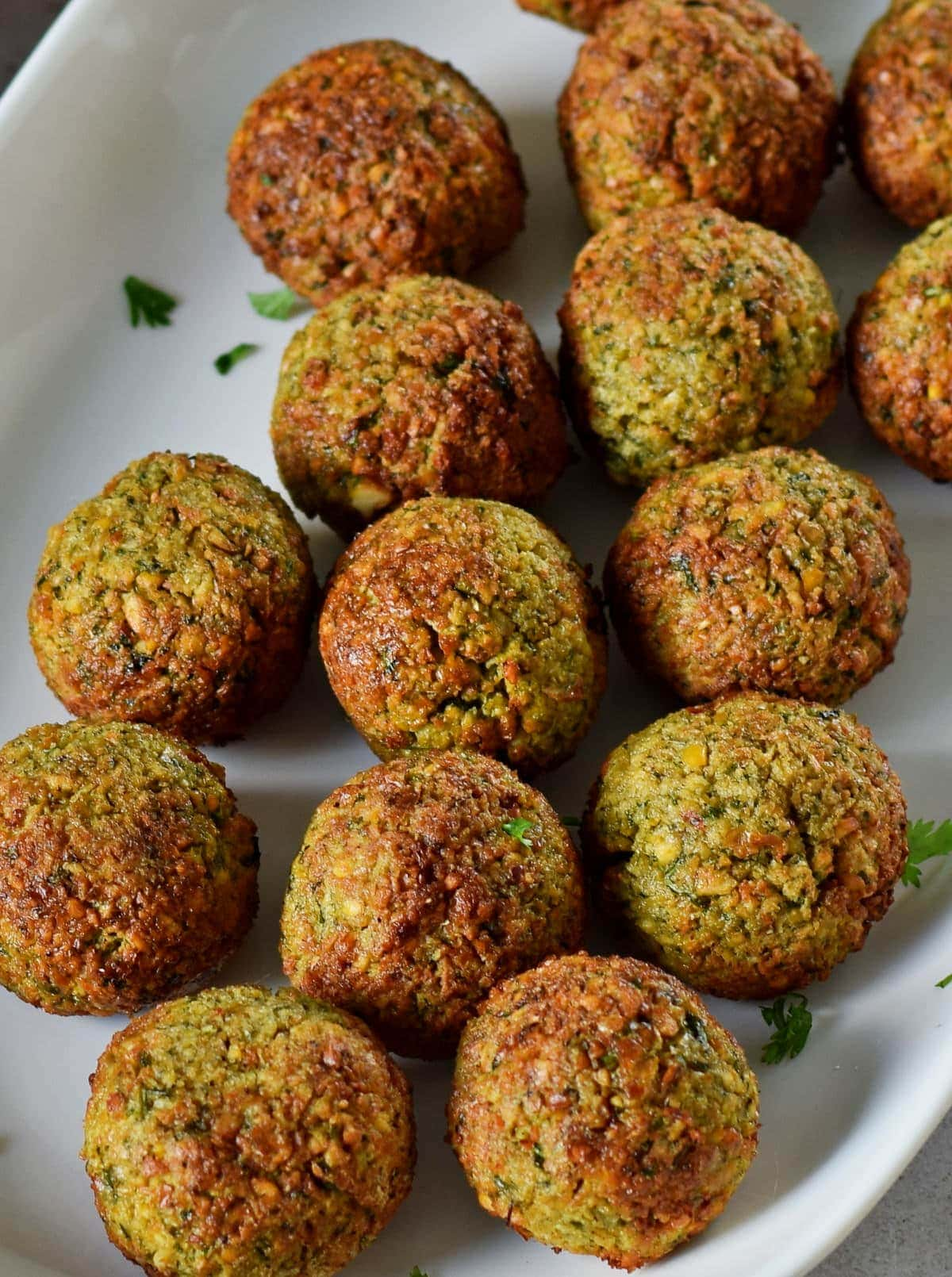 close-up of air fryer falafel on white plate